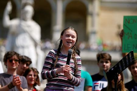 FILE PHOTO: Swedish environmental activist Greta Thunberg joins Italian students to demand action on climate change, in Piazza del Popolo, Rome, Italy April 19, 2019. REUTERS/Yara Nardi