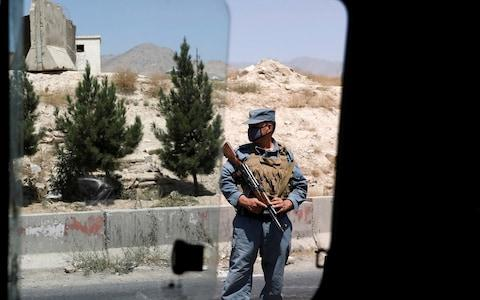 <span>An Afghan policeman keeps watch at a checkpoint on the Ghazni highway, in Maidan Shar (file photo)</span> <span>Credit: REUTERS/Mohammad Ismail </span>