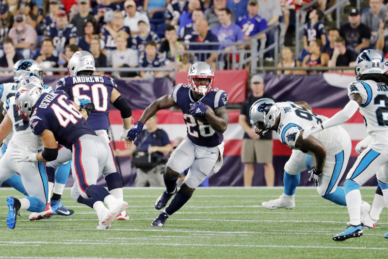 FOXBOROUGH, MA - AUGUST 22: New England Patriots running back Sony Michel (26) looks to break through the hole in the line during a preseason game between the New England Patriots and the Carolina Panthers on August 22, 2019, at Gillette Stadium in Foxborough, Massachusetts. (Photo by Fred Kfoury III/Icon Sportswire via Getty Images)