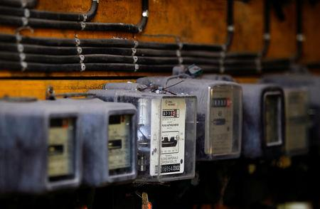 FILE PHOTO: Electricity meters are seen on a board at a housing complex in Colombo June 7, 2013. REUTERS/Dinuka Liyanawatte/File Photo