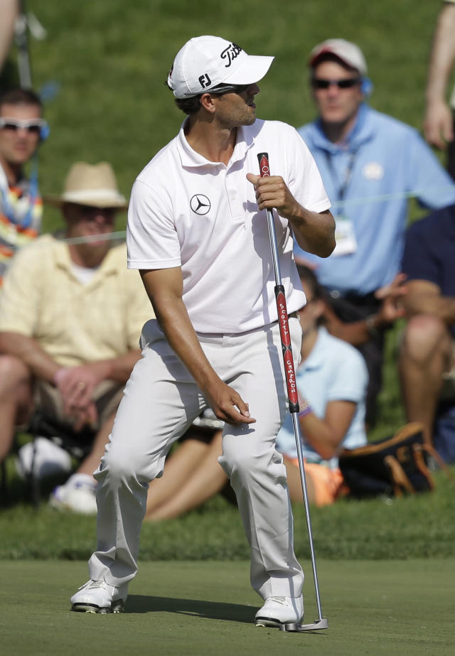 Adam Scott, of Australia, reacts to a missed putt on the 17th hole during the final round of the Memorial golf tournament Sunday, June 1, 2014, in Dublin, Ohio. (AP Photo/Darron Cummings)