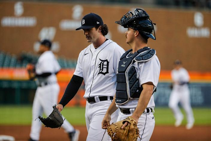 Detroit Tigers starting pitcher Casey Mize (12) talks to catcher Jake Rogers (34) after the fourth inning against Kansas City Royals at Comerica Park in Detroit on Wednesday, May 12, 2021.