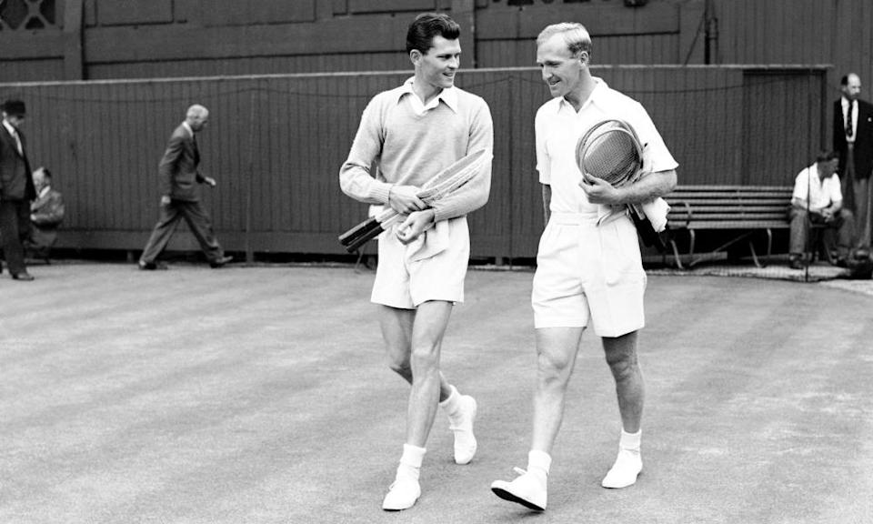 Budge Patty, left, and John Bromwich walk on to the court together in 1947.
