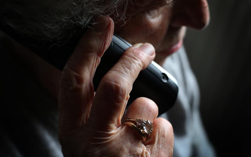 ILLUSTRATION - 11 October 2019, Bavaria, Würzburg: An elderly woman is using a cordless landline phone. Photo: Karl-Josef Hildenbrand/dpa (Photo by Karl-Josef Hildenbrand/picture alliance via Getty Images)