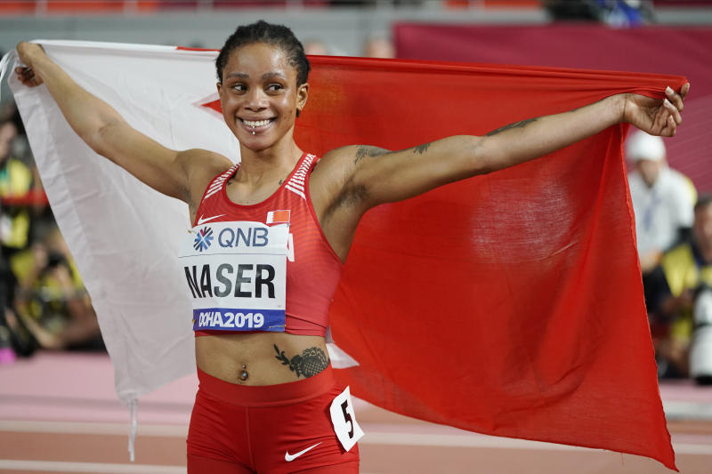 FILE - In this Oct. 3, 2019, file photo, Salwa Eid Naser, of Bahrain, celebrates after winning gold in the women's 400-meter final at the World Athletics Championships in Doha, Qatar. There have been a few high-profile names in track and field making a mess of what is supposed to be a simple process of letting drug testers know where they will be for one hour each day. World champions Christian Coleman and Naser could miss the Tokyo Games for what are known in the anti-doping world as whereabouts failures. (AP Photo/David J. Phillip, FILE)