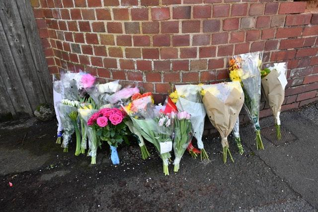Floral tributes left outside 109 Cowick Lane, Exeter, where the bodies of twins Dick and Roger Carter were discovered