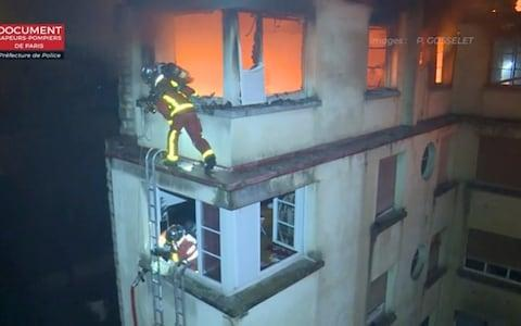 Firefighters were seen edging along the outside of the building