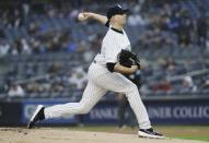 New York Yankees' James Paxton delivers a pitch during the first inning of the team's baseball game against the Minnesota Twins on Friday, May 3, 2019, in New York. Paxton became the latest Yankees player to get hurt, leaving his start after three innings because of soreness in his left knee. The team says Paxton will undergo an MRI on Saturday. (AP Photo/Frank Franklin II)