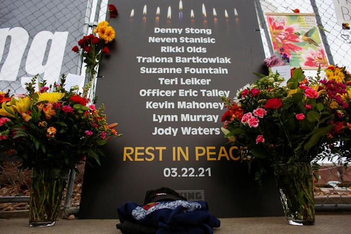 <p>A sign honoring the 10 victims is seen at the site of a mass shooting at a King Soopers grocery store in Boulder, Colorado, U.S. March 23, 2021.  </p> (REUTERS/Kevin Mohatt)
