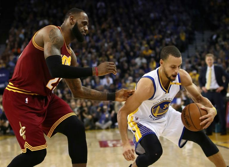 Stephen Curry (R) of the Golden State Warriors steals the ball from LeBron James of the Cleveland Cavaliers, at ORACLE Arena in Oakland, California, in January 2017