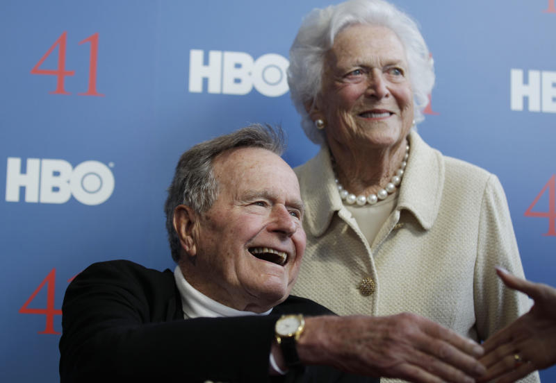 FILE - In a Tuesday, June 12, 2012 file photo, former President George H.W. Bush, and his wife former first lady Barbara Bush, arrive for the premiere of HBO's new documentary on his life near the family compound in Kennebunkport, Maine. The 41st president's month-long stay in a Houston hospital for treatment of a bronchitis-related cough appears to be nearing an end. A spokesman said Thursday, Dec. 20, 2012 that Bush possibly will be released from Methodist Hospital over the weekend and be home for Christmas.   (AP Photo/Charles Krupa, File)