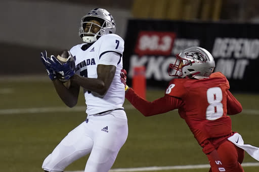 Nevada wide receiver Romeo Doubs (7) catches a pass for a touchdown over New Mexico cornerback Donte Martin (8) during the second half of an NCAA college football game Saturday, Nov. 14, 2020, in Las Vegas. (AP Photo/John Locher)