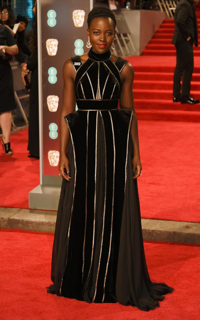 "<p>The ""Black Panther"" actress donned a black-and-gold Elie Saab number. <em>[Photo: Getty]</em> </p>"