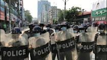 Riot police face off against protesters in Myanmar anti-coup protest