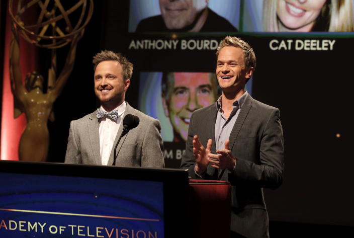Actors Aaron Paul, left, and Neil Patrick Harris announce nominations at the 65th Primetime Emmy Nominations Announcements at the Leonard H. Goldenson Theatre at the Academy of Television Arts & Sciences, Thursday, July 18, 2013, in North Hollywood, Calif. (Photo by Todd Williamson/Invision/AP)