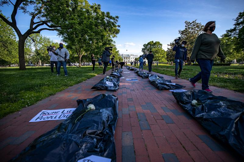 """Signs affixed to body bags read """"Trump Lies, People Die,"""" symbolizing thenearly 100,000 people in the U.S. killed so far in the pandemic. (Ari Rabin-Havt)"""