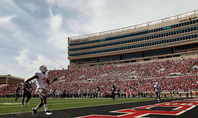 LUBBOCK, TX - NOVEMBER 12: Josh Stewart #5 of the Oklahoma State Cowboys runs for a touchdown against the Texas Tech Red Raiders at Jones AT&T Stadium on November 12, 2011 in Lubbock, Texas. (Photo by Ronald Martinez/Getty Images)