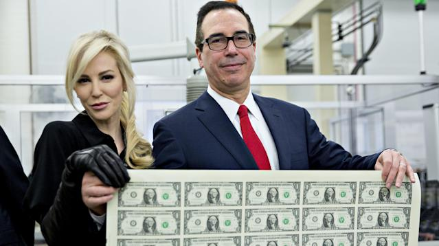 Treasury Secretary Steven Mnuchin and his wife, Louise Linton, celebrated the first batch of bucks to bear his signature with a photoshoot at the U.S. Bureau of Engraving and Printing on Wednesday.