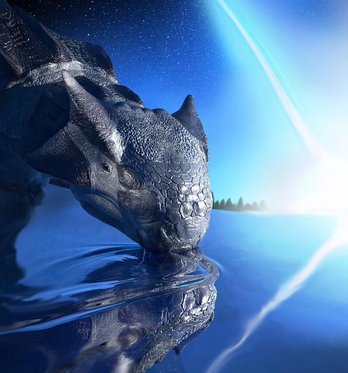 Artist's depiction of Ankylosaurus magniventris, a large armored dinosaur species, witnessing the impact of an asteroid falling on the Yucatan Peninsula 66 million years ago.