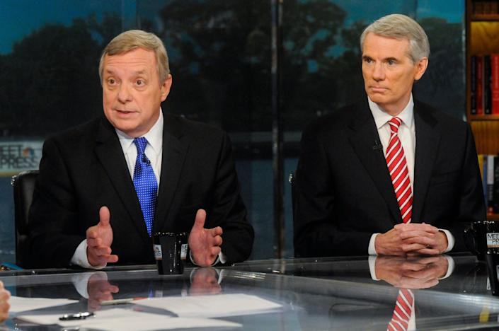 """Sens. Dick Durbin (D-Ill.), left, and Rob Portman (R-Ohio), right, appear on """"Meet the Press"""" in 2013. (Photo: NBC NewsWire via Getty Images)"""