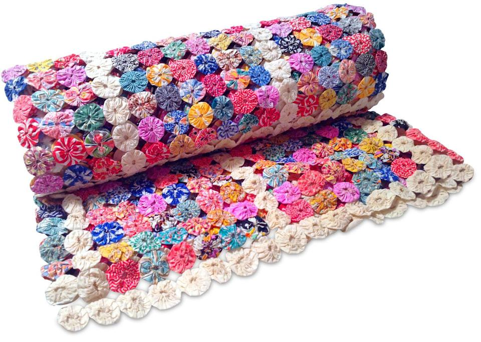 """<p>""""Hundreds of cotton circles were cut and hand-sewn otgether to make this coverlet,"""" explains Marsha Bemko of <em>Antiques Roadshow</em>, who consulted with Deborah Miler. It was a popular style in the 1930s, when the Yo-Yo toy was an American fad, hence the quirky name.</p><p><strong>What it's worth:</strong> $275</p>"""