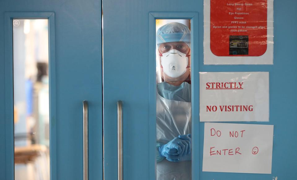 Infection control nurse Colin Clarke looking out from a Covid-19 recovery ward at Craigavon Area Hospital in Co Armagh, Northern Ireland (Niall Carson/PA) (PA Wire)