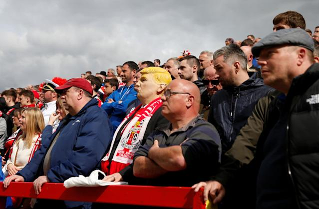"Soccer Football - League Two - Accrington Stanley v Lincoln City - Wham Stadium, Accrington, Britain - April 28, 2018 Lincoln City fan in fancy dress as US President Donald Trump Action Images/Andrew Boyers EDITORIAL USE ONLY. No use with unauthorized audio, video, data, fixture lists, club/league logos or ""live"" services. Online in-match use limited to 75 images, no video emulation. No use in betting, games or single club/league/player publications. Please contact your account representative for further details."