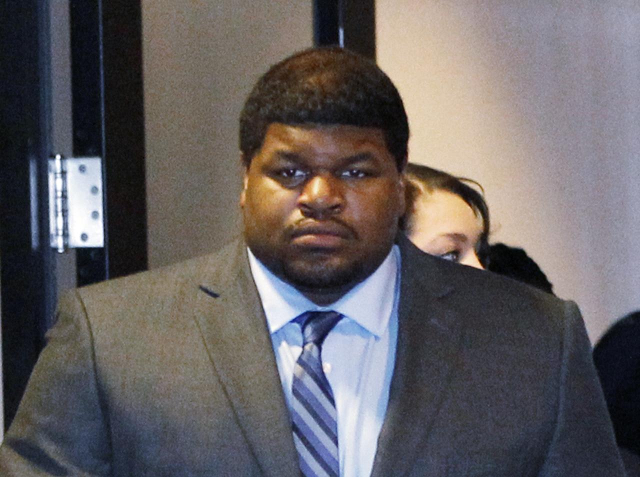 Former Dallas Cowboys player Josh Brent enters the courtroom in Dallas, Texas in this file photo taken January 14, 2014. A jury found Brent guilty of intoxication manslaughter charges on Wednesday, after he crashed his car, killing his friend and teammate Jerry Brown in 2012. REUTERS/Mike Stone/Files (UNITED STATES - Tags: CRIME LAW SPORT FOOTBALL)