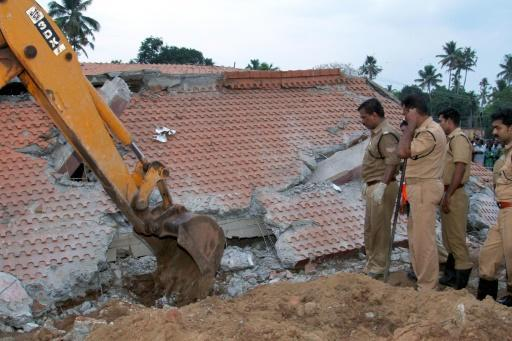 Five wanted over India temple disaster surrender to police