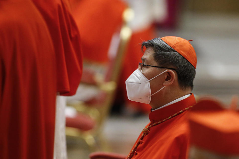Cardinal Luis Antonio Tagle wears protective masks during a consistory ceremony where 13 bishops were elevated to a cardinal's rank in St. Peter's Basilica at the Vatican, Saturday, Nov. 28, 2020. (Fabio Frustaci/POOL via AP)
