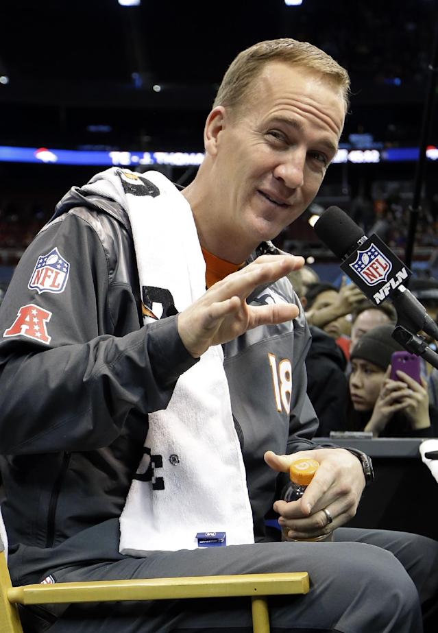 Denver Broncos' Peyton Manning answers a question during media day for the NFL Super Bowl XLVIII football game Tuesday, Jan. 28, 2014, in Newark, N.J. (AP Photo/Mark Humphrey)