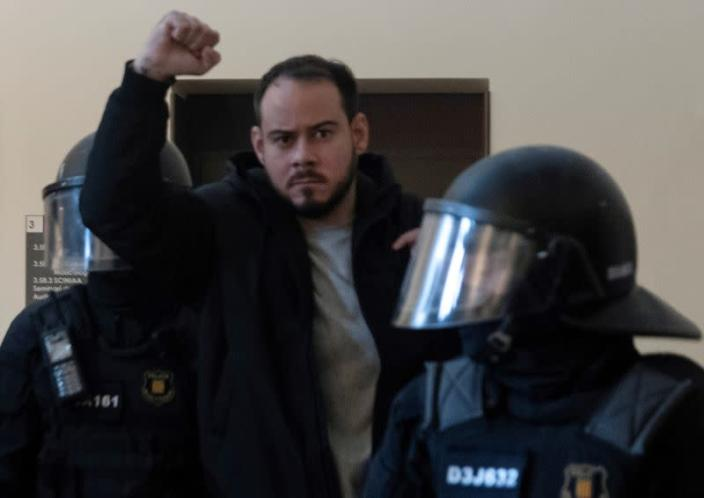 FILE PHOTO: Spanish rapper Pablo Hasel is detained by riot police inside of University of Lleida