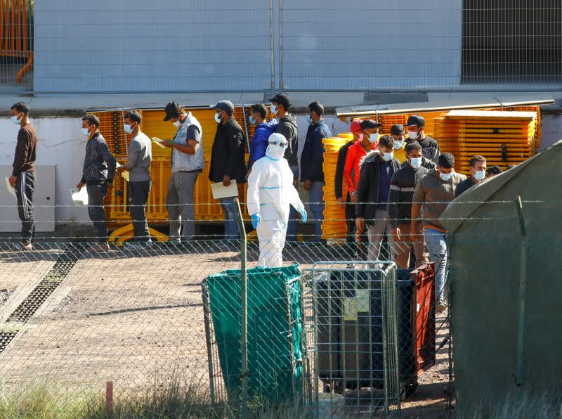 Migrants are seen in a military camp, where they are staying after being rescued by coast guards or reached the island by their own means, in Las Palmas