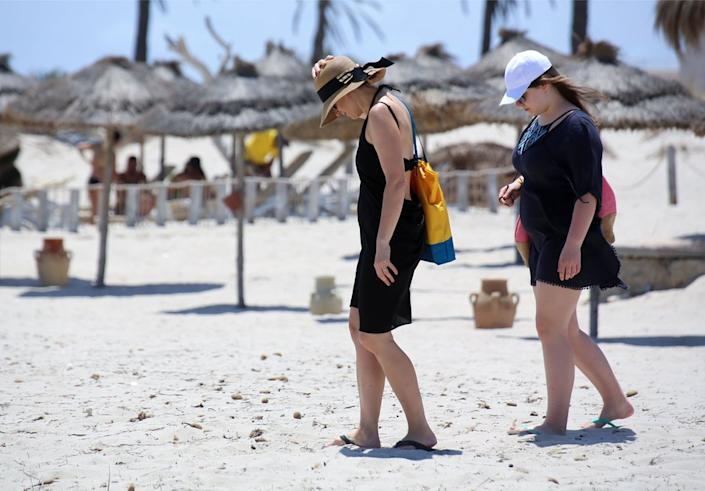 The next day holidaymakers take to the beach in Tunisia, where charter flights have resumed in a bid to boost the tourism-reliant economy.