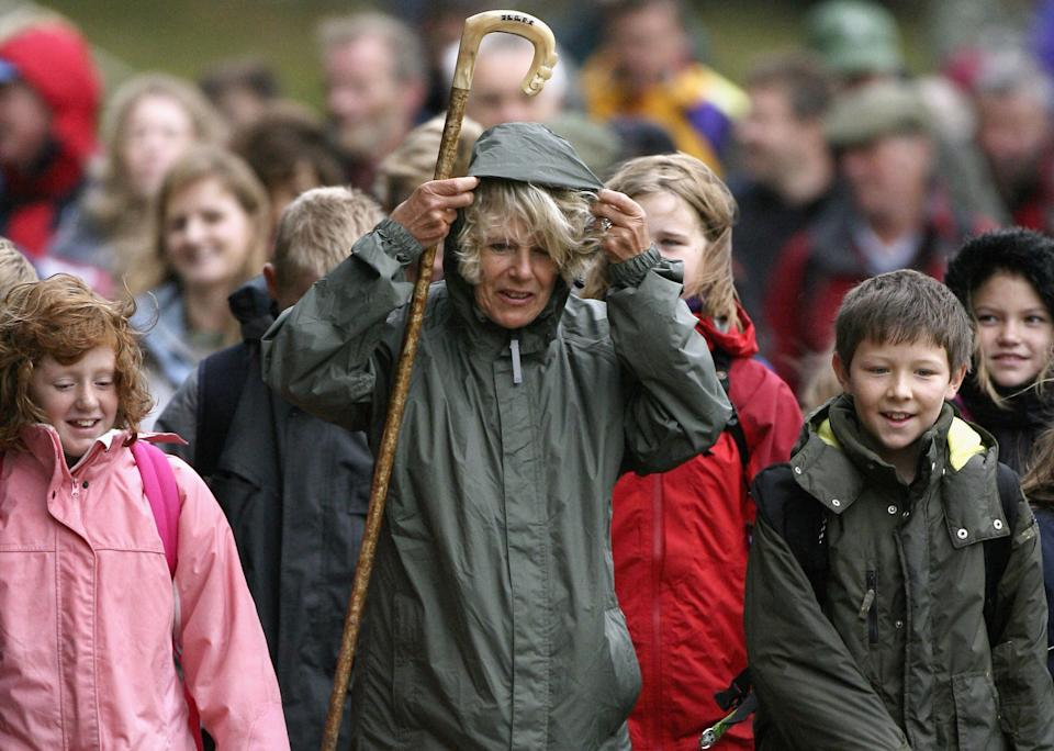 BALMORAL, UNITED KINGDOM - SEPTEMBER 20:  Camilla, Duchess of Cornwall, in her capacity as President of the National Osteoporosis Society participates in a ten-mile 'Big Bone Walk' around the Balmoral estate on September 20, 2006 in Balmoral, Scotland.  The event launches a series of 'Big Bone Walks' across the UK raising vital funds and encouraging better bone health in both children and adults.  (Photo by Jeff J Mitchell/Getty Images)