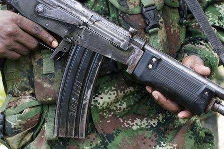 FILE PHOTO - A rebel from Colombia's Marxist National Liberation Army shows his weapon in the northwestern jungles