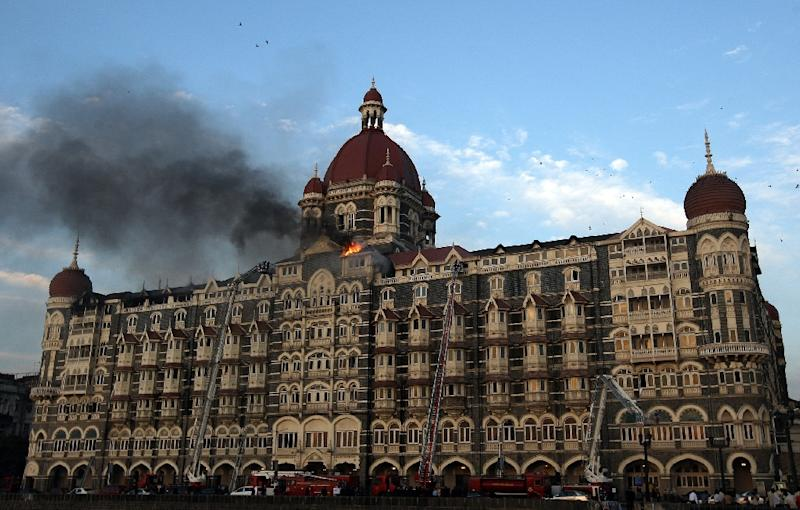Flames and smoke billow from the roof of the Taj Mahal Hotel in Mumbai on November 27, 2008 during an attack by militants (AFP Photo/Indranil Mukherjee)