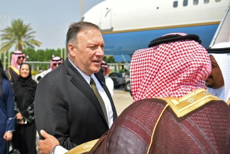 US Secretary of State Mike Pompeo speaks with a Saudi official before boarding his flight from Jeddah, Saudi Arabia to the UAE