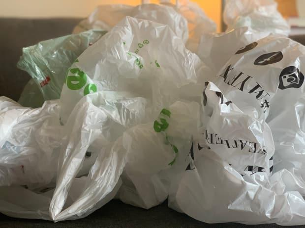 Saint John city council voted Monday night to ban plastic bags at retailers effective July 1. (Shane Magee/CBC - image credit)