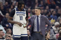 Minnesota Timberwolves head coach Ryan Saunders, right, talks with Naz Reid in the first half of an NBA basketball game against the Cleveland Cavaliers, Sunday, Jan. 5, 2020, in Cleveland. (AP Photo/Tony Dejak)