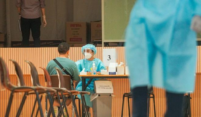 A resident participates in the citywide Covid-19 mass testing scheme in Wong Tai Sin in September. Photo: Winson Wong