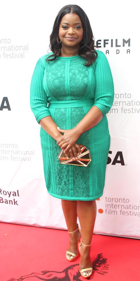 <p>The actress glowed at the premiere of<em>Black and White</em>in Toronto in a sea-green knee-length dress with lace detailing. Combined with a mirrored clutch and ankle-strap sandals, her look was perfect for the late summer weather.</p>