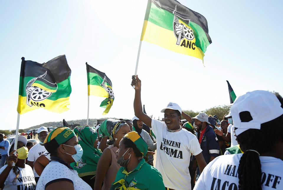 Supporters of Jacob Zuma sing and dance in front of his home in Nkandla, South Africa (REUTERS)