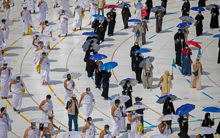 "A hadnout picture released by the Saudi ministry of media shows pilgrims circumambulating around the Kaaba (not seen in picture) at the centre of the Grand Mosque in the holy city of Mecca in Saudi Arabia at the start of the annual Muslim Hajj pilgrimage on July 29, 2020. - Mask-clad Muslim pilgrims began the annual hajj, dramatically downsized this year as the Saudi hosts strive to prevent a coronavirus outbreak during the five-day pilgrimage. The hajj, one of the five pillars of Islam and a must for able-bodied Muslims at least once in their lifetime, is usually one of the world's largest religious gatherings. (Photo by - / Saudi Ministry of Media / AFP) / RESTRICTED TO EDITORIAL USE - MANDATORY CREDIT ""AFP PHOTO / HANDOUT / SAUDI MINISTRY OF MEDIA"" - NO MARKETING NO ADVERTISING CAMPAIGNS - DISTRIBUTED AS A SERVICE TO CLIENTS (Photo by -/Saudi Ministry of Media/AFP via .) - AFP"