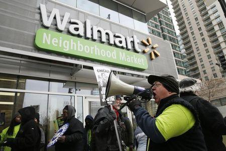 Born demonstrates for higher wages and better working conditions, outside of a Walmart in Chicago