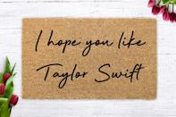 "<p>If they constantly have <a class=""link rapid-noclick-resp"" href=""https://www.popsugar.com/Taylor-Swift"" rel=""nofollow noopener"" target=""_blank"" data-ylk=""slk:Taylor Swift"">Taylor Swift</a> on in the background, this <span>I Hope You Like Taylor Swift Doormat</span> ($25) is perfect. </p>"
