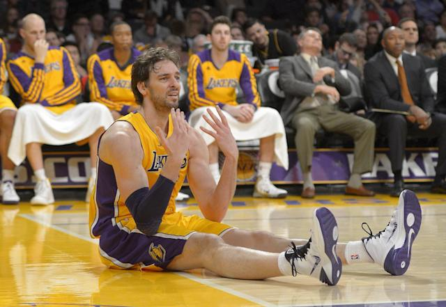 Los Angeles Lakers center Pau Gasol, of Spain, reacts after passing the ball to the wrong team from the floor during the second half of an NBA basketball game against the Cleveland Cavaliers, Tuesday, Jan. 14, 2014, in Los Angeles. (AP Photo/Mark J. Terrill)
