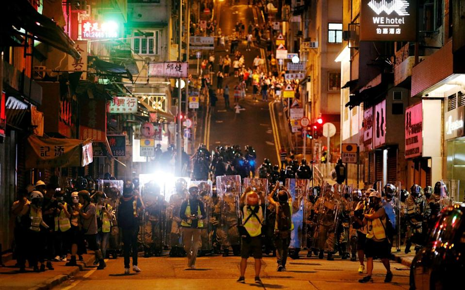 Police officers line up in Hong Kong during a protest in July - Edgar Su/Reuters