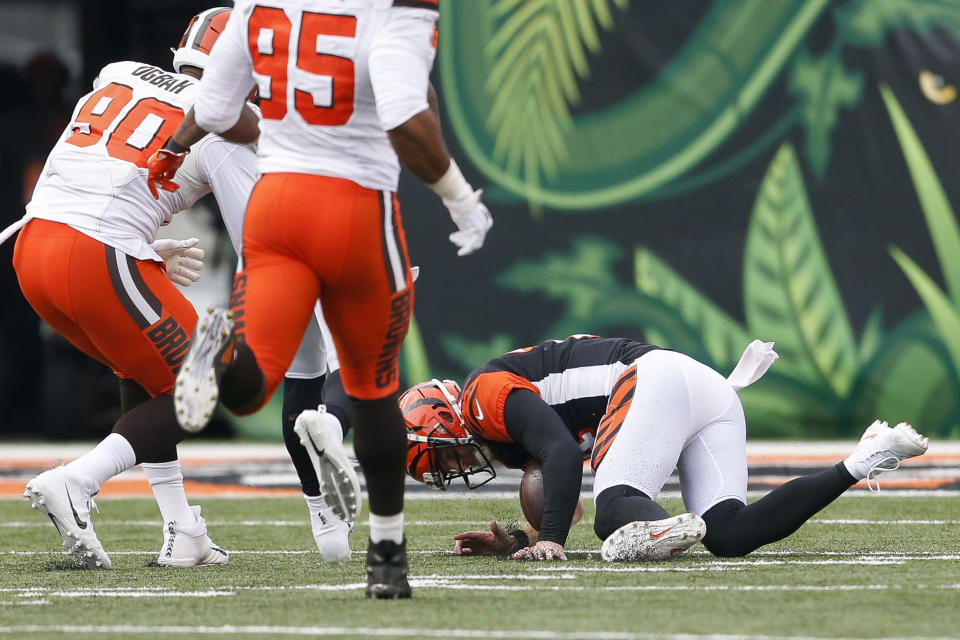 Cincinnati Bengals quarterback Andy Dalton, right, fails to recover a fumble in the second half of an NFL football game against the Cleveland Browns, Sunday, Nov. 25, 2018, in Cincinnati. (AP Photo/Gary Landers)