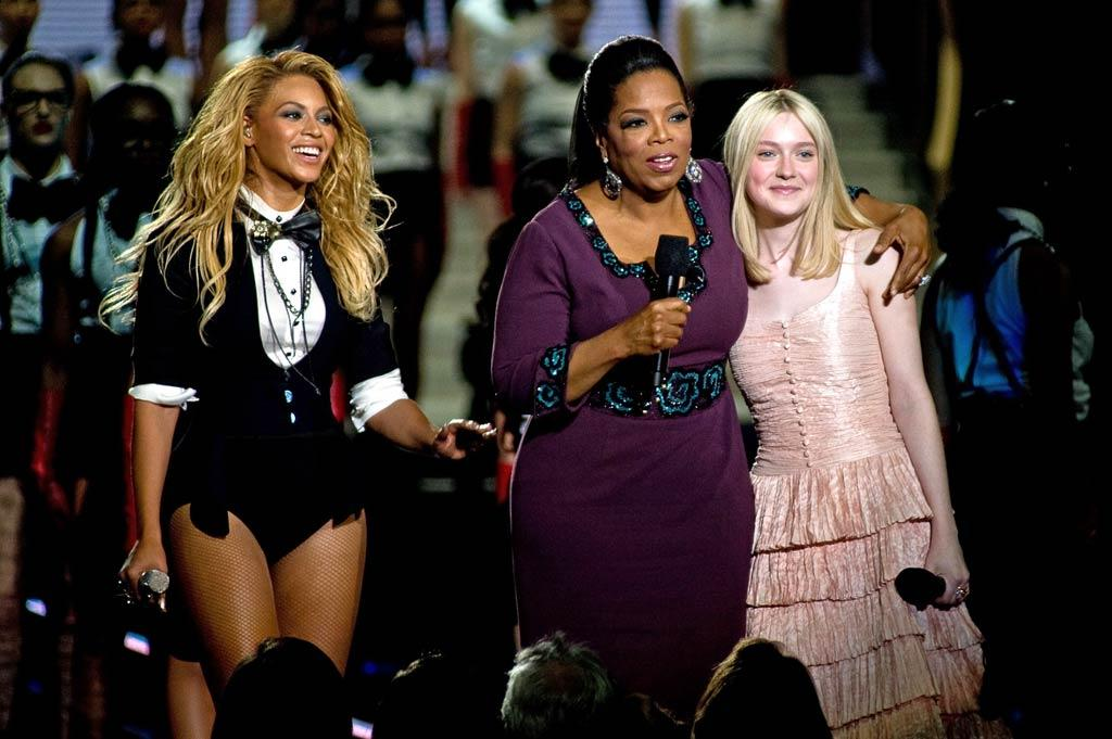 "The pop star then tried to catch her breath while Oprah chatted up Dakota Fanning, who made her first appearance on Oprah's show eight years ago when she was just 9 years old! Timothy Hiatt/<a href=""http://www.filmmagic.com/"" target=""new"">FilmMagic.com</a> - May 17, 2011"